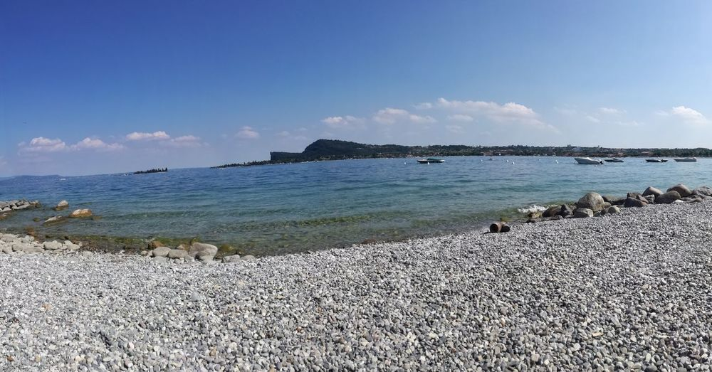 Horizon Over Water Beach Sand Travel Destinations Beauty In Nature Tourist Resort Sunny Day Outdoors Lake GARDA Lake 🌞 Coldwater Freshness Freedoom  Relaxing Moments Goodvibes Luxuryworldtraveler Nofiltersrequired Huawei P9 Lite Phone Photography Panoramic Photography EyeEmNewHere Investing In Quality Of Life The Week On EyeEm Your Ticket To Europe The Traveler - 2018 EyeEm Awards The Great Outdoors - 2018 EyeEm Awards