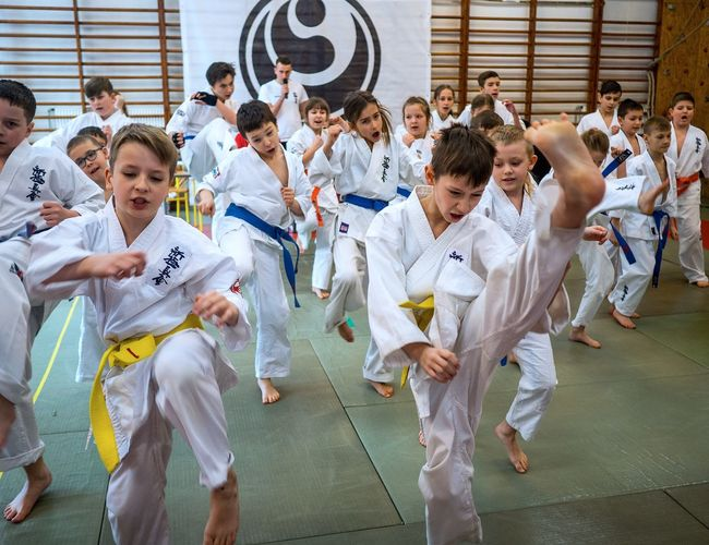 KarateKid Karate Group Of People Large Group Of People Crowd Men Real People Males  Childhood Adult Sport Women Child Offspring Day Boys Architecture Leisure Activity Uniform Lifestyles Teenager Girls