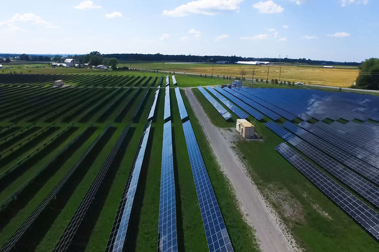 solar panels Field Environment Landscape Sky Cloud - Sky Nature Scenics - Nature Land Day Agriculture Rural Scene Farm Beauty In Nature Renewable Energy No People Alternative Energy Outdoors Tranquil Scene Patchwork Landscape Green Color Solar Panels