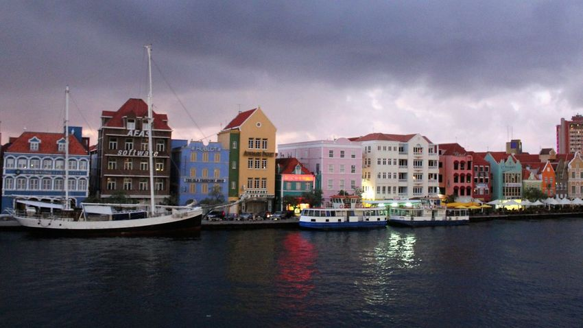 Willemstad is waking up in the early Morning 2013 Journey Caribbean Island Caribbean Love ❤ Caribbean Life Cityscape Waking Up Architecture Building Exterior Built Structure Caribbean Caribbean City Caribbean Cruise Caribbean Cruise Ports City Cloud - Sky Day Early Morning Nature Nautical Vessel No People Outdoors Sky Travel Blog Water Waterfront Stories From The City