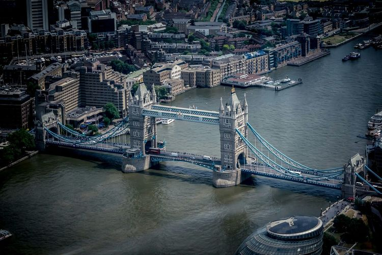 High angle view of tower bridge over thames river amidst buildings