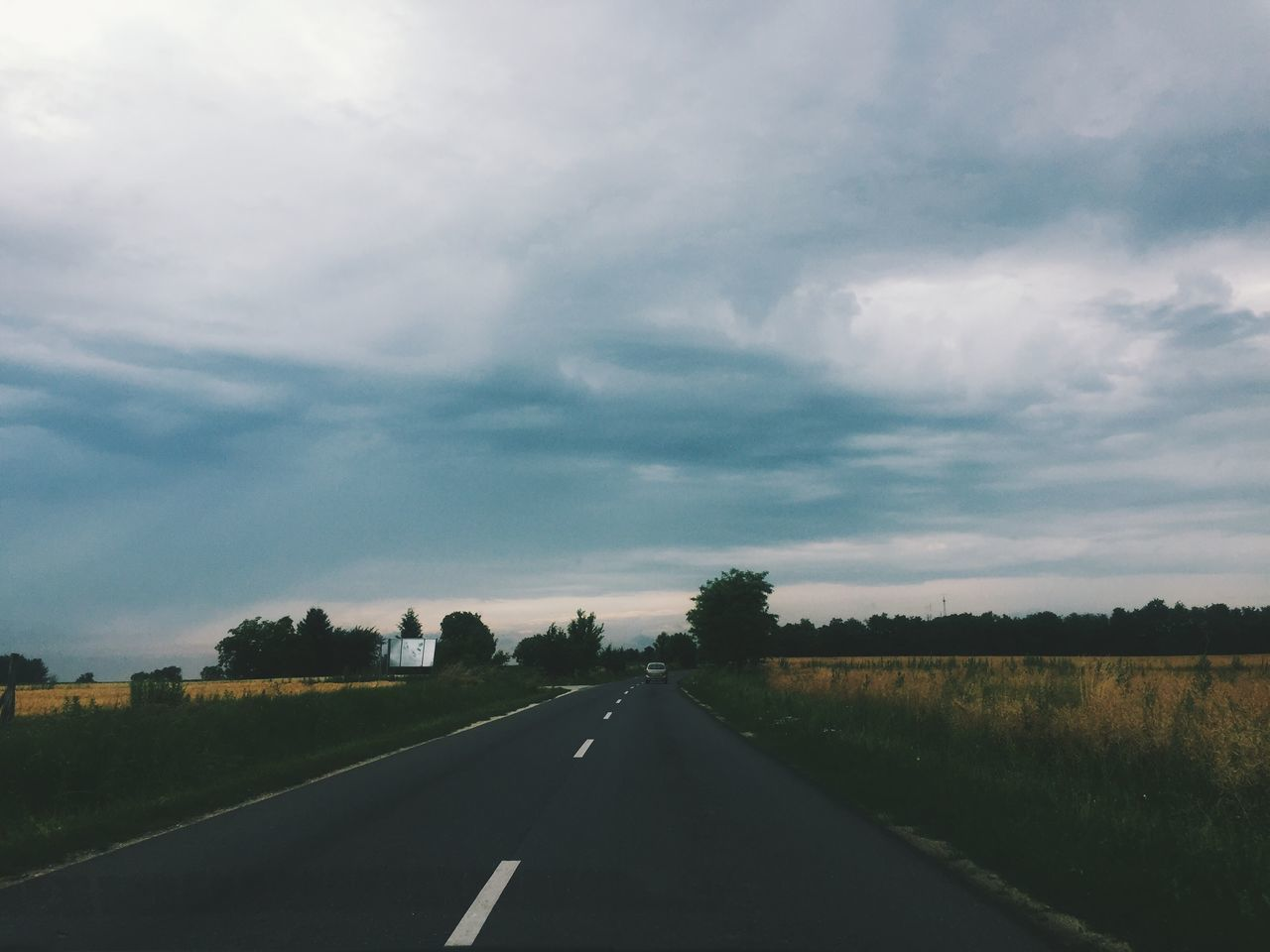 road, the way forward, transportation, diminishing perspective, sky, tree, cloud - sky, nature, landscape, scenics, no people, car, tranquil scene, journey, tranquility, beauty in nature, day, outdoors, grass