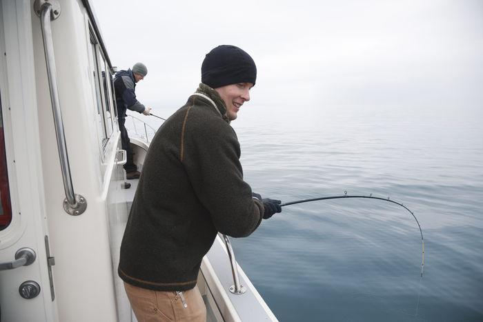 Alaska Boat Fisherman Fishing Leisure Activity Man Ocean Salmon Fishing Saltwater USA Water Young Adult