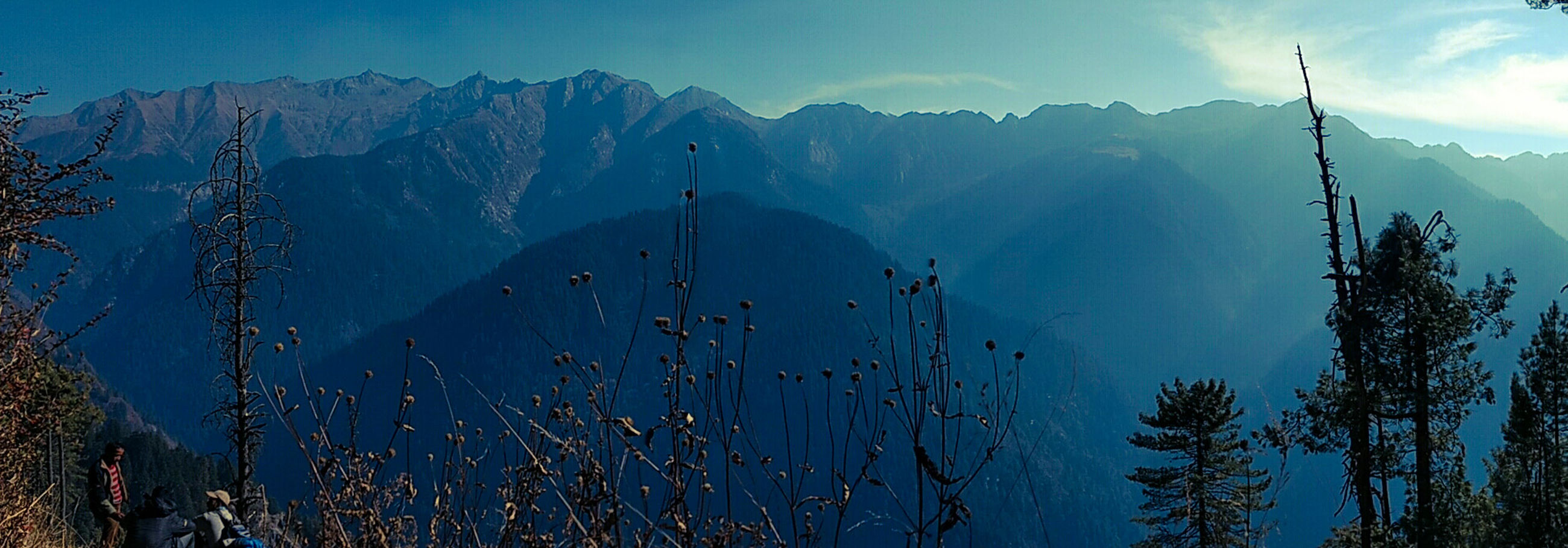 mountain, beauty in nature, scenics - nature, mountain range, tranquil scene, sky, tranquility, non-urban scene, nature, plant, tree, idyllic, no people, environment, day, outdoors, panoramic, landscape, remote, snowcapped mountain, formation, mountain peak