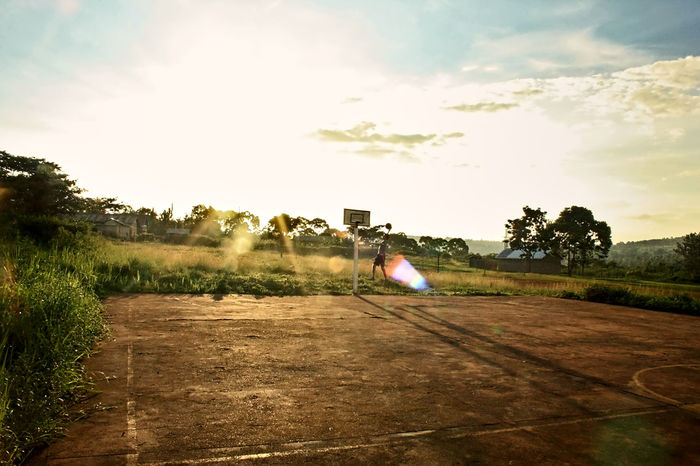 uganda Africa Basket Basketball Blue Cloud Colorful Evening Experimental Green Lens Flare Light Lightreflection Outdoors People Play Play Basketball couler Sky Streetball Sun Sunbeam Sunset Uganda  Yellow