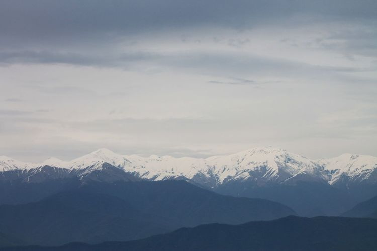 Scenic view of snowcapped mountains against sky - caucasus mountains