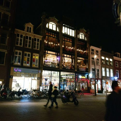 Architecture Night Travel Destinations People Illuminated Adult Built Structure City Building Exterior Men Large Group Of People Nightlife Thehague  Lahaya Market People Watching People Photography People And Places Shopping Center Police Force Adults Only