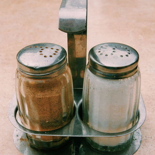 Close-up of salt and pepper shaker on table