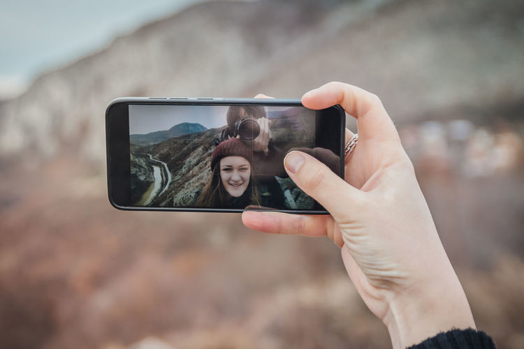 Happy couple taking Romantic selfie. Romantic travel. Portrait Tool Technology Photography Themes Human Hand Wireless Technology Photographing Mobile Phone Holding Hand Activity Smart Phone Communication Real People Focus On Foreground Lifestyles Human Body Part Portable Information Device Screen Connection Leisure Activity Outdoors Finger Selfie Couple #NotYourCliche #NotYourCliche Love Letter My Best Photo Moms & Dads