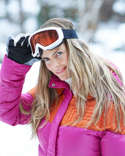 portrait of young woman in snow Active Adult Beautiful Woman Blond Hair Clothing Cold Temperature Cross-Country Skiing Day Fashion Females Fun Hair Hairstyle Happy Holiday Leisure Leisure Activity Lifestyle Lifestyles Long Hair Nature On The Way One Person Outdoors Outside People Pink Color Portrait Real People Scarf Ski Ski Goggles Ski Holiday Ski Trip Skier Skiing Smile Snow Sport Warm Clothing Winter Winter Holiday Winter Sports Woman Women Young Adult Young Women