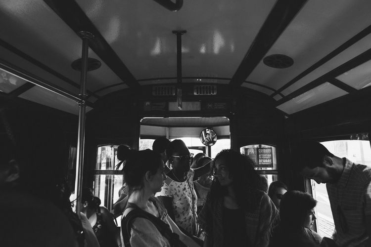 Casual Clothing Crowd Group Of People Indoors  Journey Lifestyles Medium Group Of People Men Mode Of Transport People And Places Person Public Transport Restaurant Rush Hour Standing Transportation Travel Vehicle Interior Visit Window