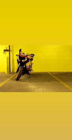 Motorcycle Yellow Yellow Background Land Vehicle Riding Sky Stationary Parking Parking Lot Parking Garage Parking Sign