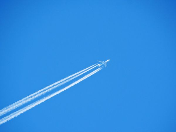 Plane in the sky. Vapor Trail Airplane Blue Transportation Flying Mode Of Transport Air Vehicle Mid-air Airshow Speed Low Angle View Clear Sky Copy Space Travel Smoke - Physical Structure No People Outdoors Journey Day Sky Aeroplane Fly Jet Jumbo Jet Vacations