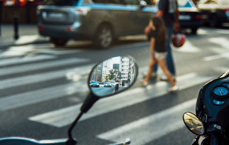 Reflection on side-view mirror of vehicle