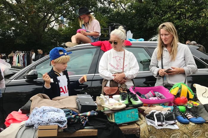 Battersea car boot sale Mid Adult Mid Adult Women Togetherness Sitting Day Women Adult Full Length Outdoors Young Adult Men Young Women People Adults Only Mammal Battersea Car Boot Sale Car Boot Sale London