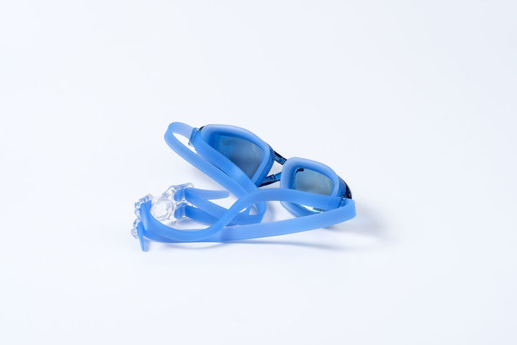 Blue Clean Equipment Glossy Goggle Goggles Rubber Swim Swimming Swimming Goggle White White Background Studio Shot Copy Space Cut Out Indoors  Still Life No People Close-up Celebration Life Events High Angle View Ribbon - Sewing Item Ribbon Single Object Emotion Two Objects Positive Emotion Event Love Personal Accessory