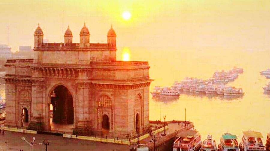 Battle Of The Cities Architecture Sunset Built Structure Building Exterior City History Orange Color Arch Travel Destinations Dusk Sun Tourism Sky Spire  Famous Place City Life Outdoors Monument Cloud - Sky Mumbai India Indianphotography New Talent