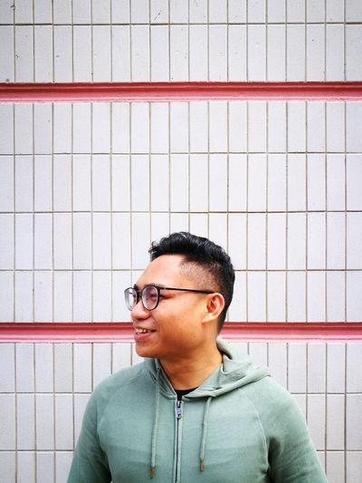 Smile. EyeEm Selects Eyeglasses  Innovation Technology Headshot Black Hair Casual Clothing Grid Posing Short Hair Structure Square Shape Rectangle Geometric Shape Seamless Pattern Thinking Thoughtful Pensive Head And Shoulders EyeEmNewHere