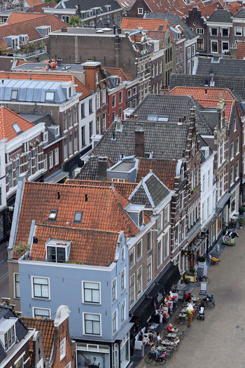The center of Delft from above Delft Netherlands Roof Weekend Architecture Building Building Exterior Built Structure Cafe City Cityscape Crowd Day High Angle View House Incidental People Leisure Activity Location Outdoors People Place Roof Street Town