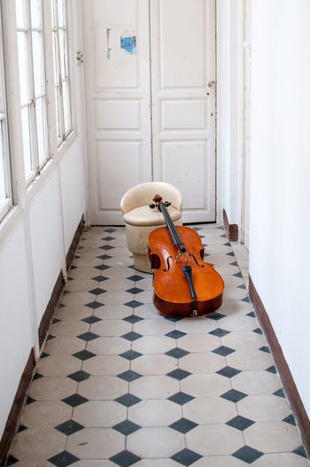 Day Indoors  Cello No People Conformity In A Row Large Group Of Objects Diminishing Perspective Surface Level