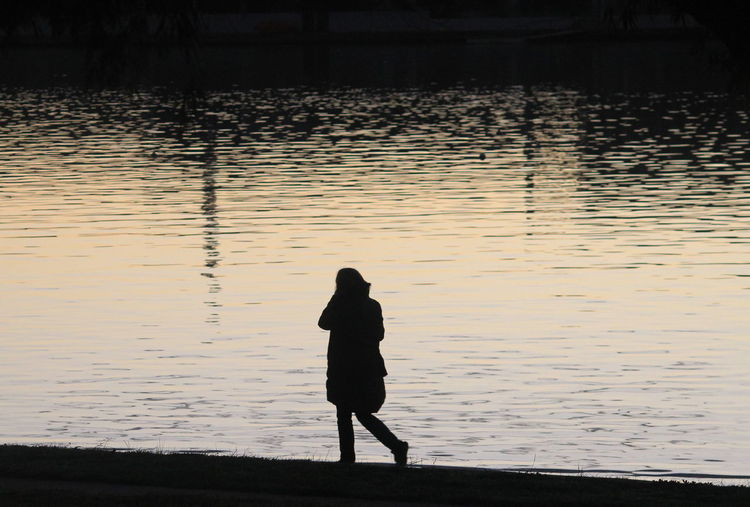 Silhouette woman standing in water
