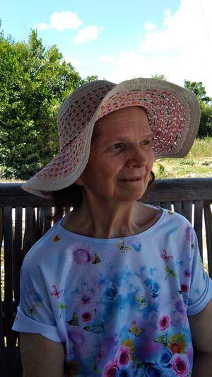 Smiling senior woman wearing hat