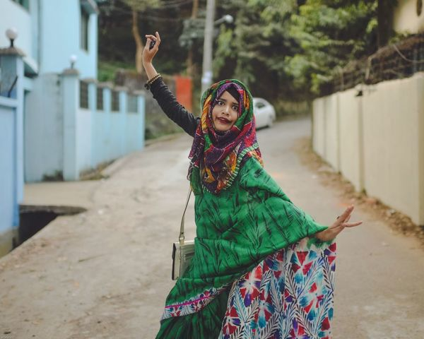 Dancing Lady . Cultures Outdoors One Woman Only One Person Adult Only Women Day Uniqueness Fun Women Portrait Happiness Celebration Smiling Cheerful Lifestyles Multi Colored Adapted To The City Saree Arts Culture And Entertainment Chittagong Bangladesh Women Around The World EyeEm Diversity Art Is Everywhere The Street Photographer - 2017 EyeEm Awards The Portraitist - 2017 EyeEm Awards The Photojournalist - 2017 EyeEm Awards BYOPaper! Neon Life