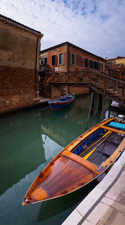 Cannaregio Travel Destinations Reflections And Shadows Reflections In The Water Panoramic Views Vertical Panorama Travel Traveling Travel Photography Wooden Boats Wooden Textures Motorboats Boats Canals Water Outdoors No People Architecture Day Nautical Vessel Building Exterior Sky