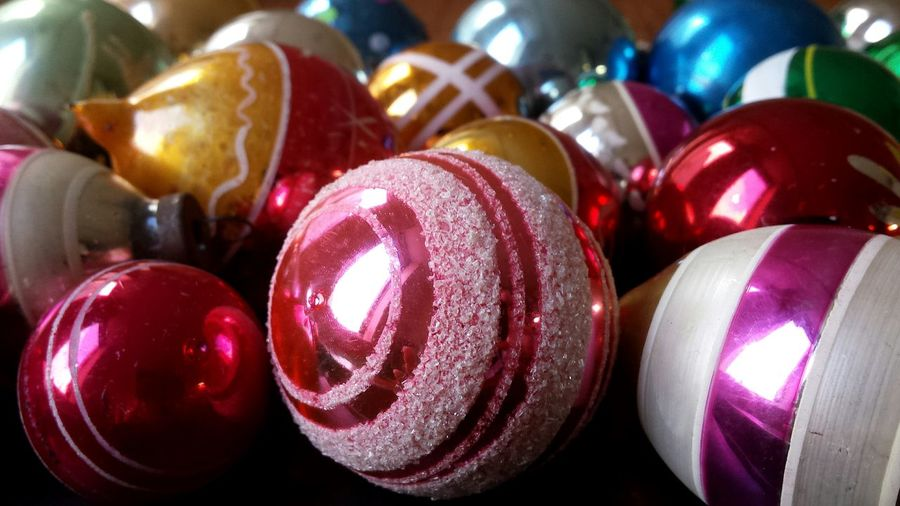 Close-up of colorful baubles on table