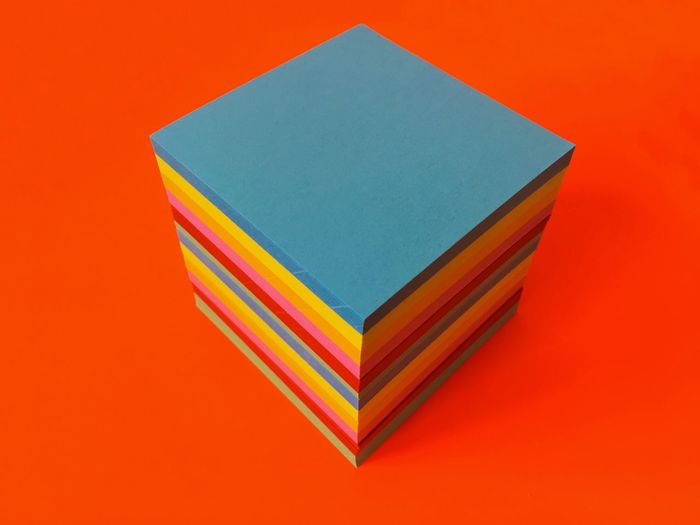 High Angle View Of Colorful Paper Box On Orange Background