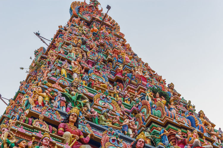 Hindu god and goddess sculptures on temple tower Gopuram Hindu Gods Hinduism Tamil Architecture Celebration Clear Sky Colorful Crowd Culture And Tradition Day Goddess Hindu Temple Large Group Of People Low Angle View Multi Colored Mylapore Outdoors People Religious  Sculptures Sky Temple Architecture Templephotography Tower