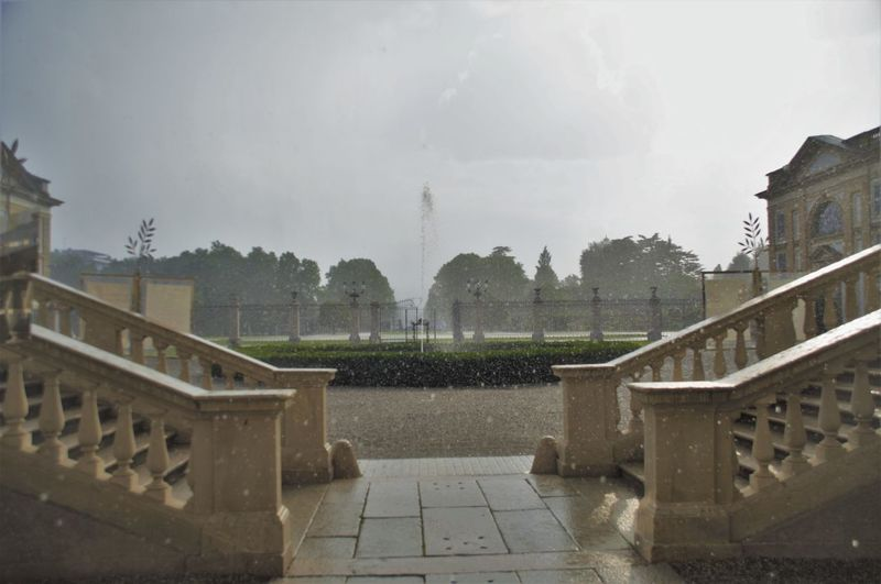 Summer rain Architecture Building Exterior Built Structure Day Fountain Garden History No People Outdoors Rain Rain And Sun Sky Staircase Storm Summer Rain Travel Destinations Tree Water