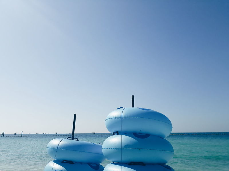 Water Clear Sky Sea Cold Temperature Blue Beach Floating On Water Copy Space Buoy Sky