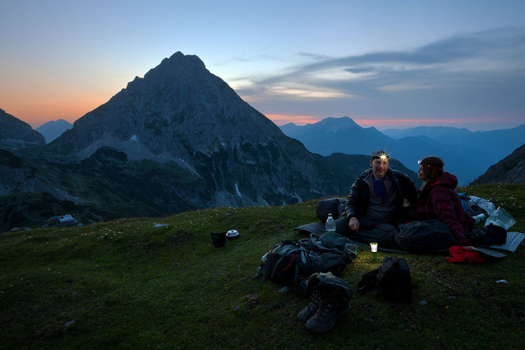 Outdoor Night Hiking Nightphotography Twilight Adventure Alps Beauty In Nature Bivouac Biwako Camp Dusk Landscape Mountain Mountain Range Nature Night Non-urban Scene Outdoors Outside People Scenics - Nature Sitting Sky Sunset Tranquility