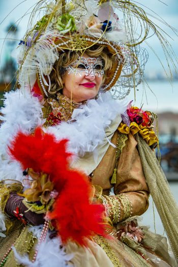 Carnival Carnival In Venice Carnival Masks Close-up Costume Day Front View Lifestyles Looking At Camera Mask - Disguise One Person Outdoors People Portrait Real People Red Venetian Mask Venice Wearing