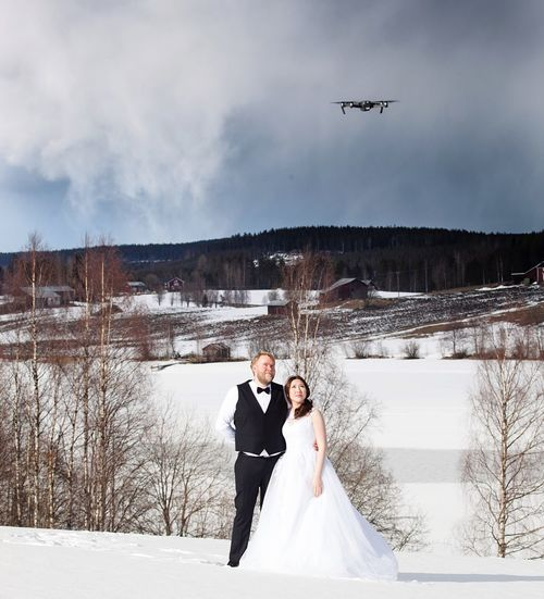 Bride And Groom On Snow Covered Landscape