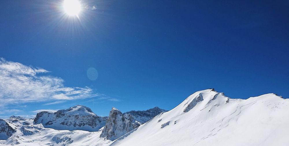 Sky Snow Cold Temperature Winter Mountain Scenics - Nature Beauty In Nature Snowcapped Mountain Tranquility Tranquil Scene Blue Nature Lens Flare Mountain Range Sun Sunbeam Idyllic No People
