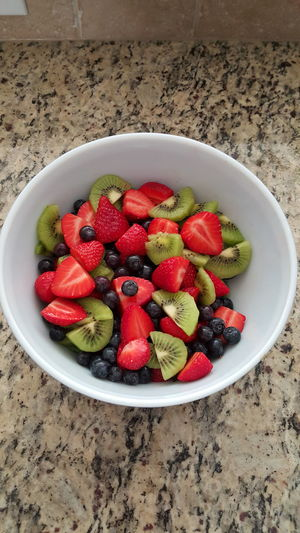 Fresh fruit salad Vertical Fruit Strawberry Healthy Eating Freshness Red High Angle View Bowl Food No People Close-up Day
