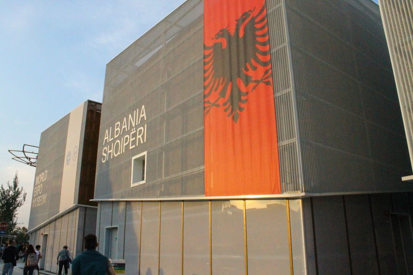 Albania Architecture Building Exterior Built Structure Day Flag Low Angle View Modern No People Outdoors Red Shqiperia Sky