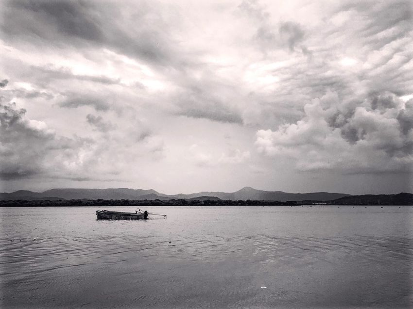 Nature Water Boat Scenics Waterfront Tranquil Scene Beauty In Nature Sky Cloud - Sky Nature Mountain Dramatic Sky Outdoors Day Mountain Range riverside First Eyeem Photo blacknwhite Black And White black and white photography