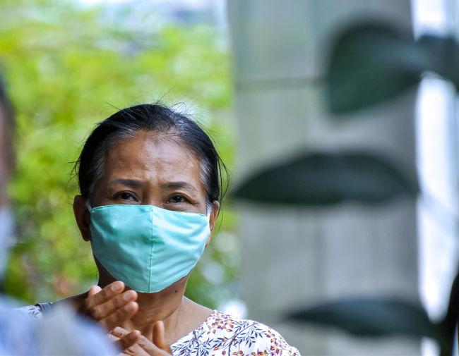 Portrait of mature woman wearing mask