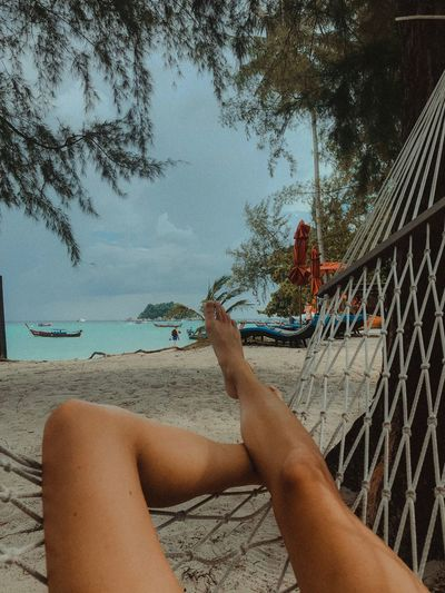 Sitting on the hammock at the beach Ocean Nature Sea Hammock Time Hammock Human Body Part Human Leg Lifestyles Beach Personal Perspective Tree Nature Relaxation Water Land Day Sky Outdoors