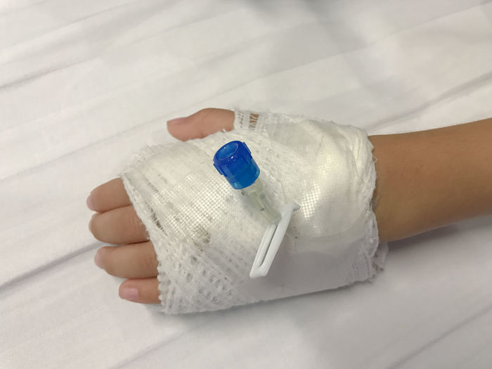 Close up of iv plug in baby hand for saline solution Close-up Day Healthcare And Medicine Holding Human Body Part Human Finger Human Hand Indoors  One Person People Real People