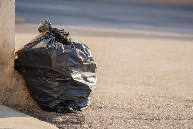 Close up of plastic bag on road