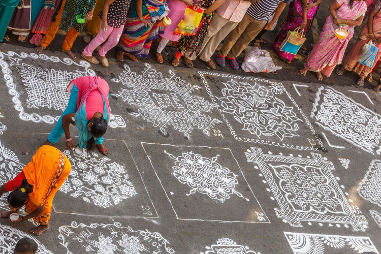 Indian traditional kolam (tamil language) or rangoli is drawn using white colored rice during festival season Abstract Photography Asian Culture Diwali Festival Season Hindu Hinduism Rice Paddy Colorful Culture And Tradition Decoration Design Drawing - Art Product Flour Handmade Men Mylapore Outsdoor Pongal Streetphotography Traditional Women