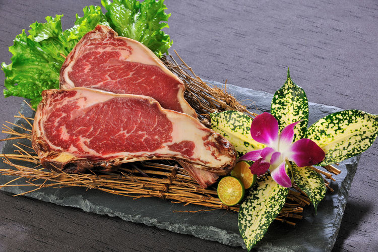 Meat and flower on slate over table