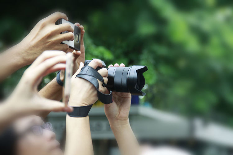 People photographing from cameras
