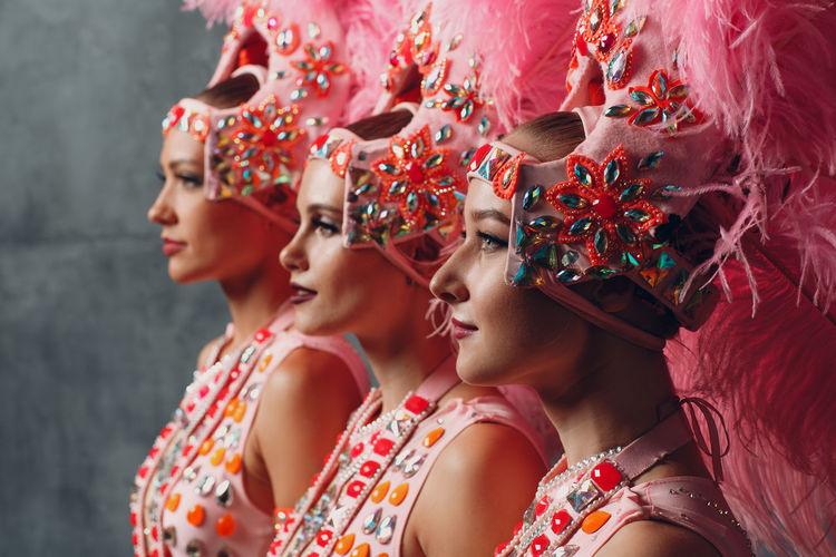 Samba dancers standing against wall