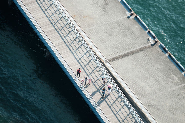 High angle view of people on pier over sea