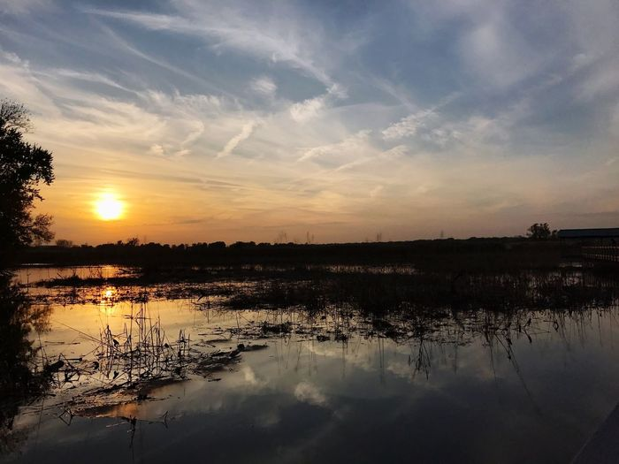 Sunset over marshland in Autumn. Reflection Nature Sunset Sky Tranquil Scene No People Cloud - Sky Beauty In Nature